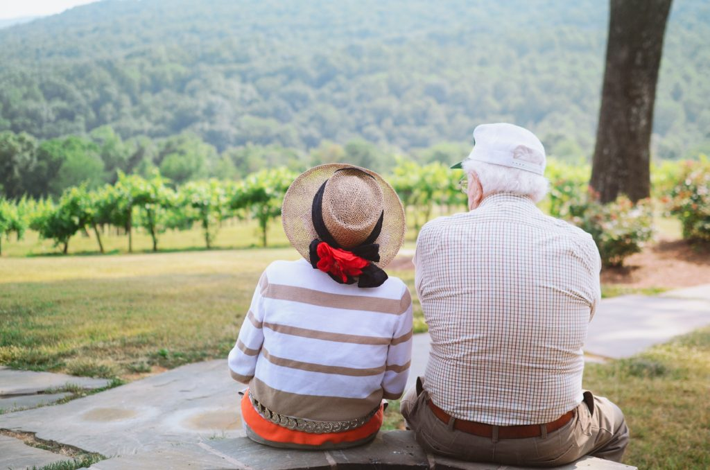 Grandparents enjoying the view at the grandsons wedding, Photo by Christian Bowen on Unsplash